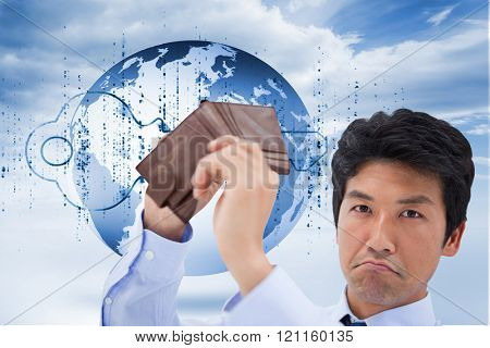 Businessman showing his empty wallet against digital blue key with matrix and a planet