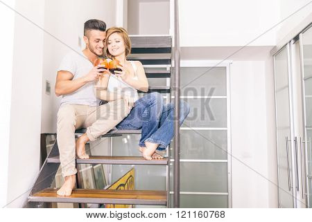 Couple Drink Wine At Home