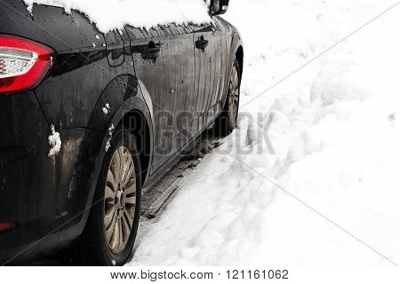 Side Wiew Of A Car In The Snow