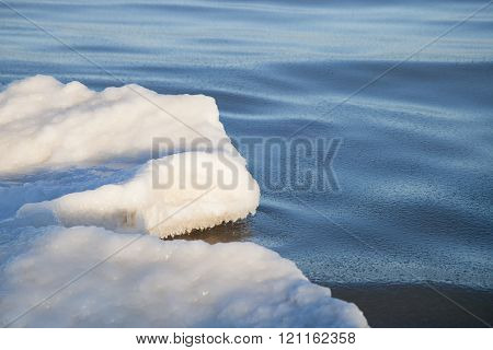 Part of the ice floe in the sea under the sun