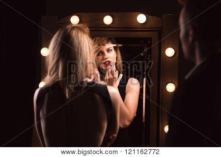 Woman Applying Red Lipstick