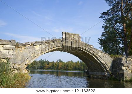 In the arch of the Hunchback bridge september day. Gatchina palace park