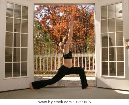 Woman Doing Yoga In Front Of Nature