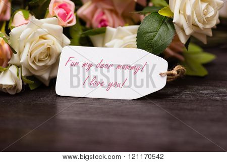 Mothers day congratulation card with rustic roses on wooden board