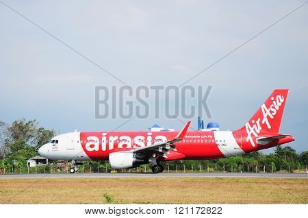 Airasia aircraft takes off at Kota Kinabalu International Airport