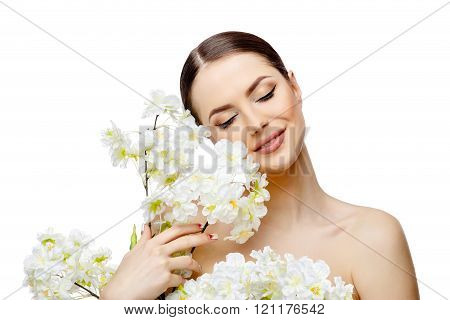 Beautiful Woman with Clean Fresh Skin holding flowering branches
