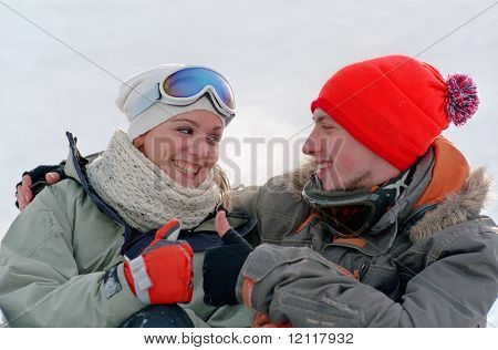 young couple have a fun at winter vacation