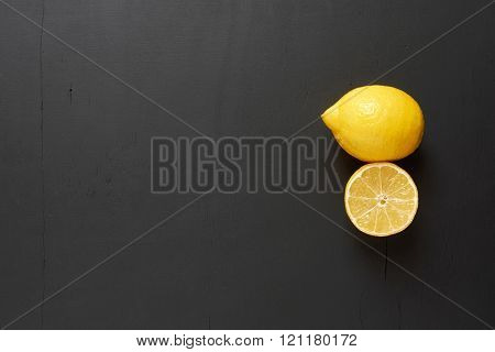 Lemon And Lemon Slice. Clearance Black Background.