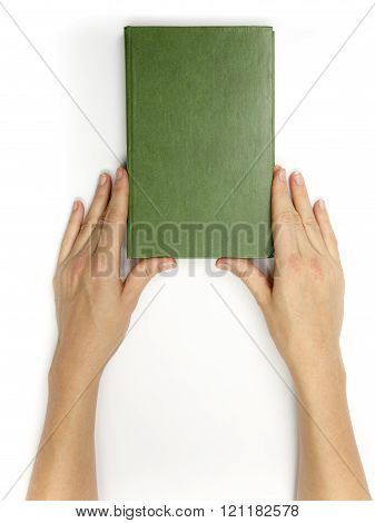 Hands hold blank red hardcover book on white background