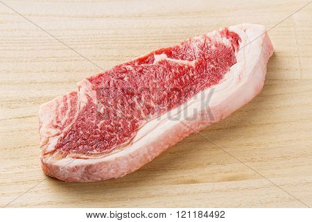 Beef Striploin Steak On Chopping Board