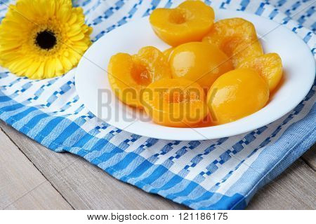 Cut peaches in syrup and a yellow gerber