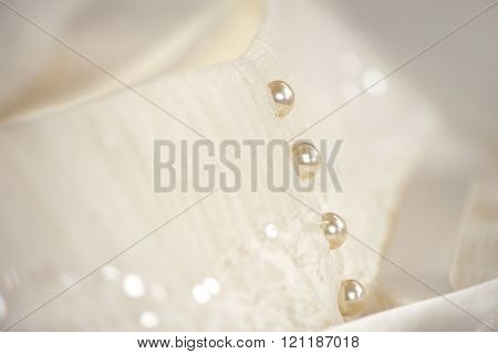 Line of pearl buttons on a white wedding dress
