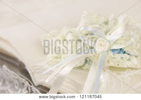 Wedding garter on a white book or album