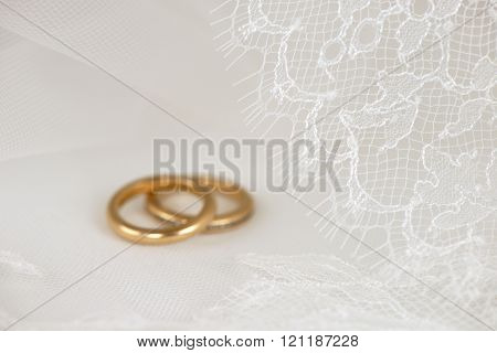 White wedding lace with golden rings