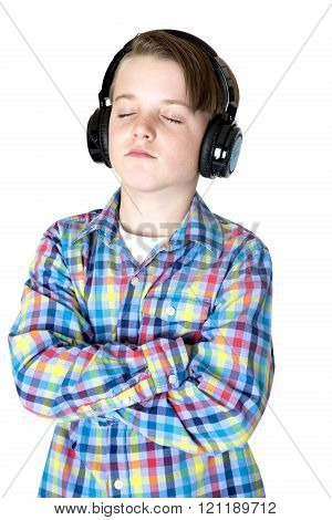 Preteen Boy Listening To Music With Headphones With Eyes Closed Peaceful Expression