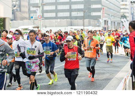 TOKYO, JAPAN - FEBRUARY 28 2016: Marathon in Tokyo Japan downtown. Marathon run in Tokyo, Japan