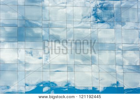 Blue Sky And Clouds Reflected In Office Building