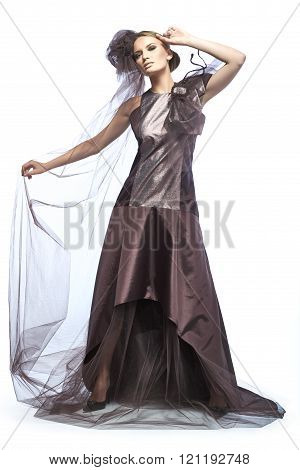 Beautiful tall girl dressed in expensive dark broun dress.