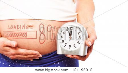 Pregnant woman showing clock and bump against loading