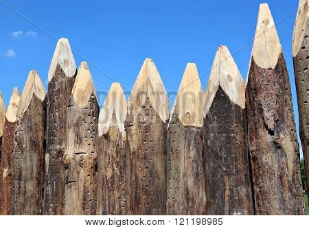Fence Made Of Sharpened Pointed Logs