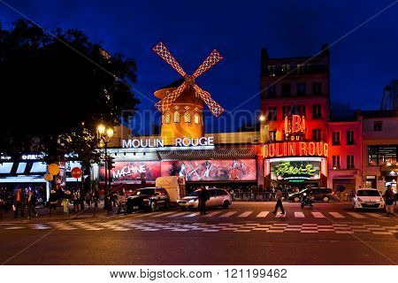 The Moulin Rouge by night in Paris, France