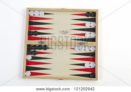 leisure board games backgammon with chips and dice isolated over white