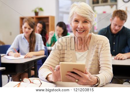 Senior woman using tablet computer at adult education class