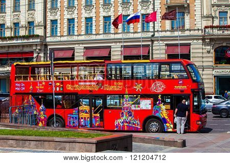Red double-decker tour bus on Moscow street