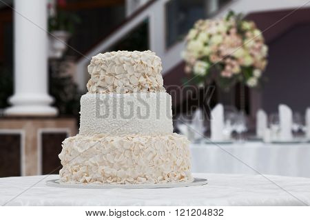 Beautiful wedding cake on the table in restaurant