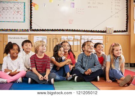 Elementary school kids sitting on classroom floor