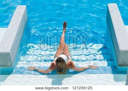 Woman sitting in a swimming pool