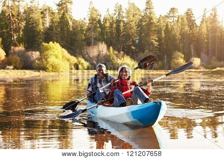 Senior African American Couple Rowing Kayak On Lake