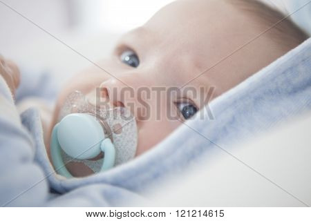 Baby with blue pacifier