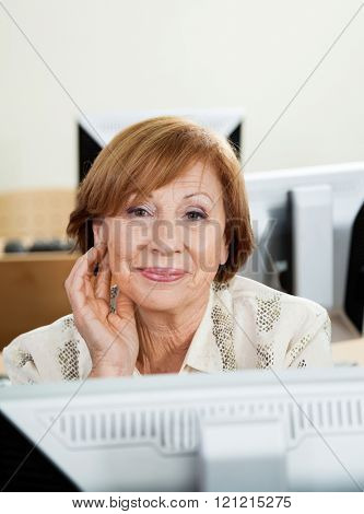 Happy Senior Woman In Computer Class