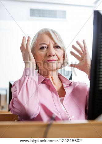 Portrait Of Stressed Senior Woman In Computer Class