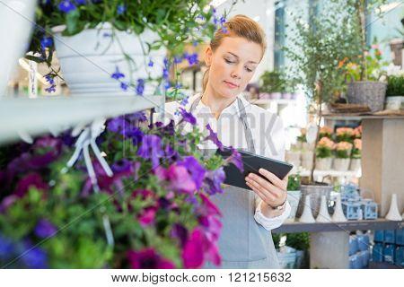 Woman Using Digital Tablet In Flower Shop