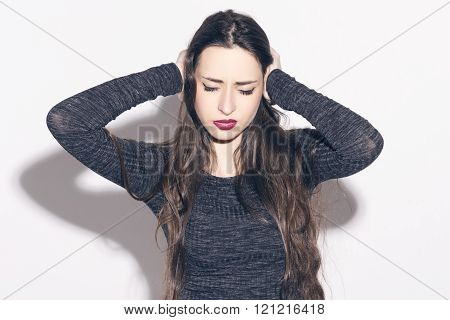 Unhappy Woman Covering Closed Ears With Her Hands.