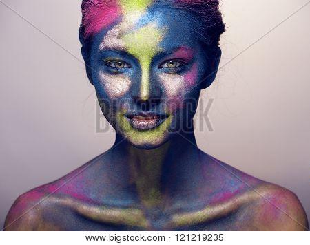 beauty woman with creative make up like Holi celebration in India closeup
