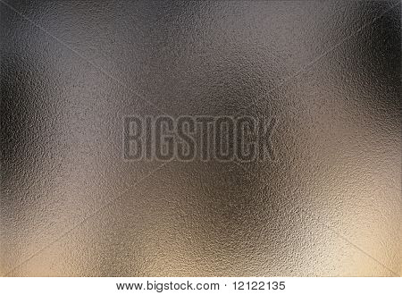 Very rough chrome metal sheet with a slight reflection of the environment