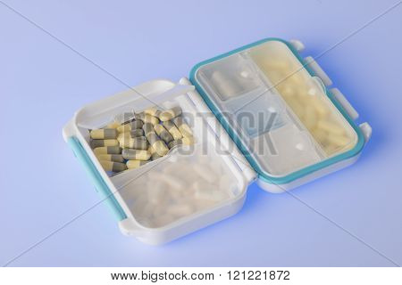 Pill box with variety of pills and supplement