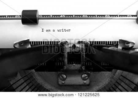 Detail closeup of old typewriter with paper for writing communication I am a writer