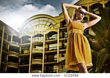 Young attractive woman over hotel in the evening