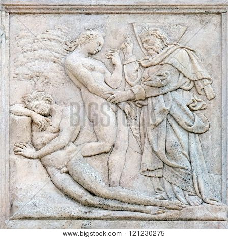 BOLOGNA, ITALY - JUNE 04: Creation of  Eve, Genesis relief on portal of Saint Petronius Basilica in Bologna, Italy, on June 04, 2015