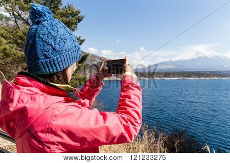 Woman take the photo on Fujisan
