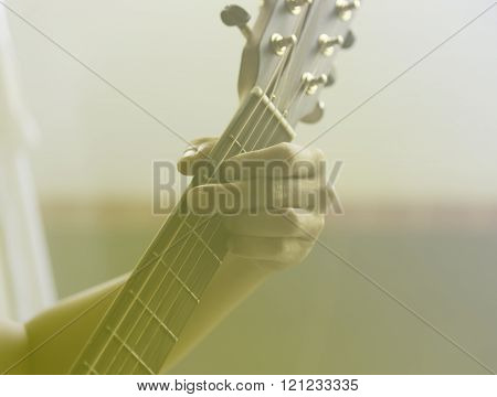 Unidentified Male Play Guitar With Left Arm Closeup With Sunlight Yellow Softlight