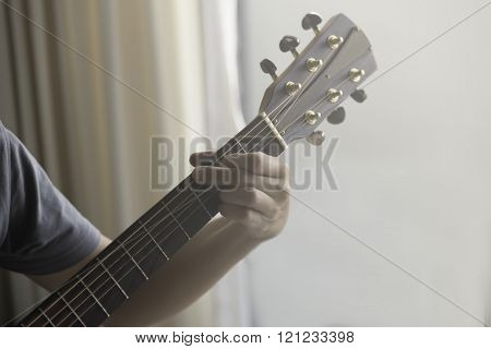 Unidentified Male Play Guitar With Left Arm With Soft Light