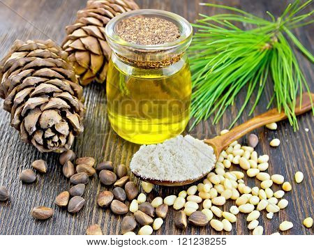Flour cedar in spoon with oil on dark board