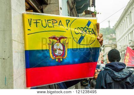 Quito, Ecuador - August 27, 2015: Ecuadorian flag with anti president message during mass demonstrat