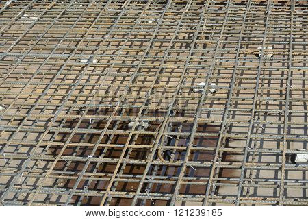SEPANG, MALAYSIA - MAY 15, 2014: Floor slab reinforcement bar on timber form work at the construction slab in Sepang, Selangor, Malaysia
