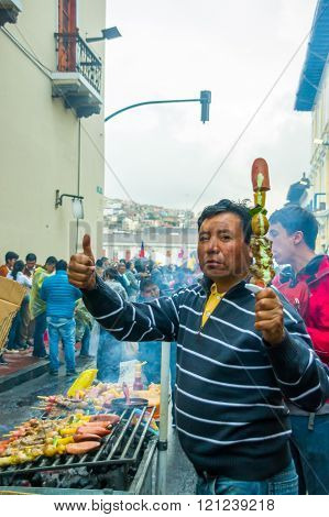 Quito, Ecuador - August 27, 2015: Man selling barbecue skewers in city streets during anti governmen